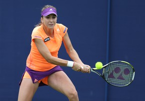 EASTBOURNE, ENGLAND - JUNE 15: Belinda Bencic of Switzerland plays a backhand against Anna Schmiedlova of Slovakia during their third round qualification match on day two of the Aegon International at Devonshire Park on June 15, 2014 in Eastbourne, England.  (Photo by Steve Bardens/Getty Images)