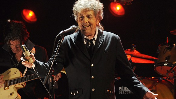 "FILE - In this Jan. 12, 2012, file photo, Bob Dylan performs in Los Angeles. The panel that awards the Nobel Prize in literature says this year's winner will be announced Thursday, Oct. 5, 2017. In 2015 and 2016, the award went to writers outside the conventional conception of ""literature"" as novels and poetry. Svetlana Alexievich's books are artistic sociopolitical reportage, and Bob Dylan's lyrics arguably have more power as song than on the page. (AP Photo/Chris Pizzello, File)"
