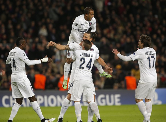 PSG's Zlatan Ibrahimovic, center, celebrates after scoring the opening goal with his teammates during a Group F Champions League soccer match between FC Barcelona and PSG at the Camp Nou stadium in Barcelona, Spain, Wednesday Dec. 10, 2014. (AP Photo/Emilio Morenatti)