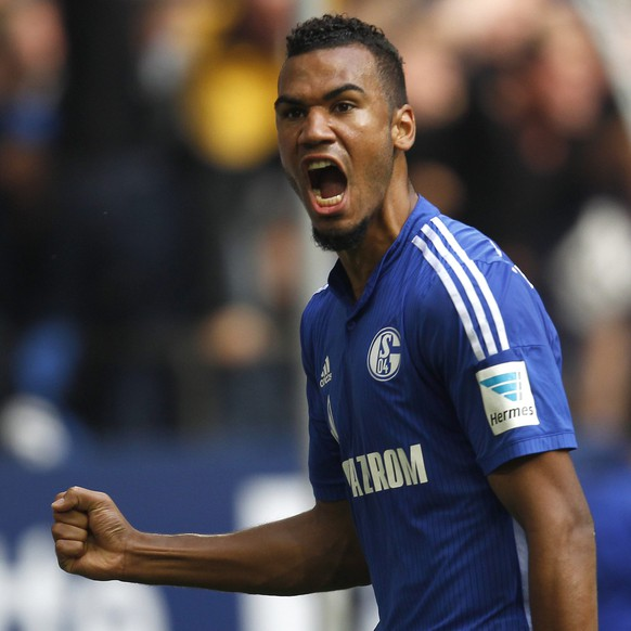 Schalke 04's Eric-Maxim Choupo Moting celebrates a goal against Borussia Dortmund during the Bundesliga soccer match in Gelsenkirchen September 27, 2014. REUTERS/Ina Fassbender (GERMANY - Tags: SPORT SOCCER) DFL RULES TO LIMIT THE ONLINE USAGE DURING MATCH TIME TO 15 PICTURES PER GAME. IMAGE SEQUENCES TO SIMULATE VIDEO IS NOT ALLOWED AT ANY TIME. FOR FURTHER QUERIES PLEASE CONTACT DFL DIRECTLY AT + 49 69 650050