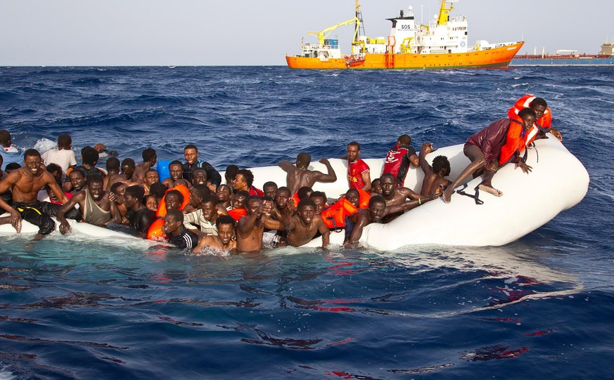 epa05265406 A handout photgraph made available by the Ong Sos Méditerranée showing migrants on a snking inflatable boat before being rescued by  the Aquarius ship of the humanitarian group SOS Mediterranee, and taken to  Lampesusa, Italy, 18 April 2016. Six bodies were recovered and 108 migrants were rescued from a semi-submerged rubber dinghy as boat arrivals accelerate amid calm seas. A private rescue ship, the Aquarius, run by humanitarian group SOS Mediterranee found the bodies on the rubber dingyon 17 April 2016.  EPA/ONG SOS MEDITERRANEE / HANDOUT  HANDOUT EDITORIAL USE ONLY/NO SALES