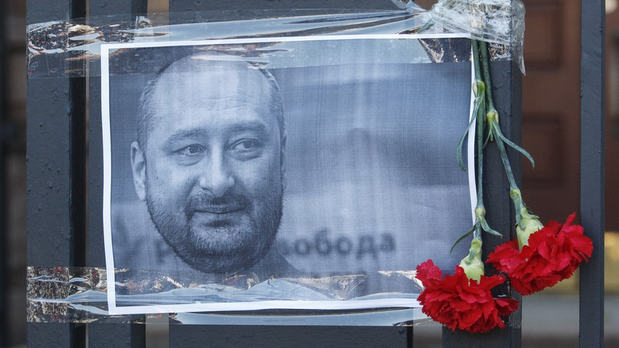 epa06772534 The Russian opposition journalist Arkady Babchenko portrait is seen on a fence of Russian embassy in Kiev, Ukraine, 30 May 2018. Russian opposition journalist Arkadiy Babchenko, who lived in Ukraine, was shot on 29 May 2018 in his Kiev home by three shots to his back and died from his wounds on the way to hospital, local media report. Babchenko was criticizing Russian authorities and writing about arrests of Crimean-Tatarian journalists in the Crimea after annexation of it by Russia.  EPA/STEPAN FRANKO