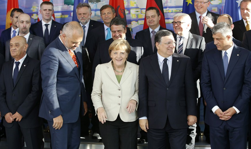 (Front row L-R) Bosnian Prime Minister Vjekoslav Bevanda, Albanian Prime Minister Edi Rama, German Chancellor Angela Merkel, European Commission President Jose Manuel Barroso and Kosovo Prime Minister Hashim Thaci pose with members of their delegations for a group picture as they attend the