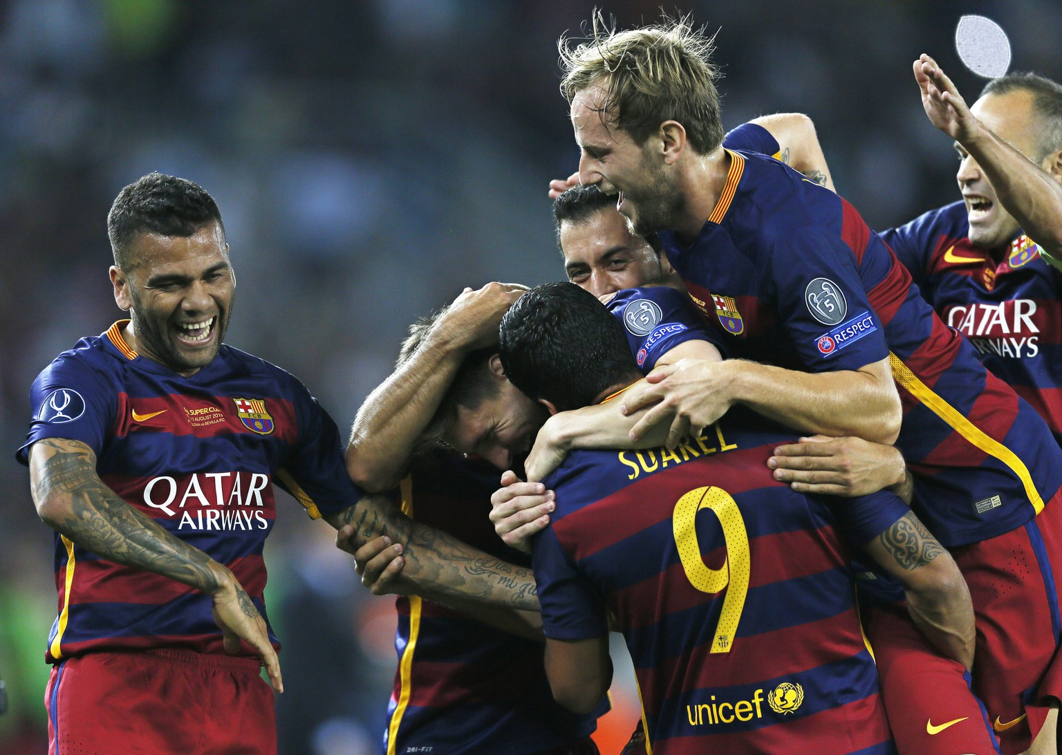 epa04880323 Players of Barcelona celebrate after scoring a goal during the UEFA Super Cup match between FC Barcelona and Sevilla at Boris Paichadze Dinamo Arena in Tbilisi, Georgia, 11 August 2015.  EPA/YURI KOCHETKOV