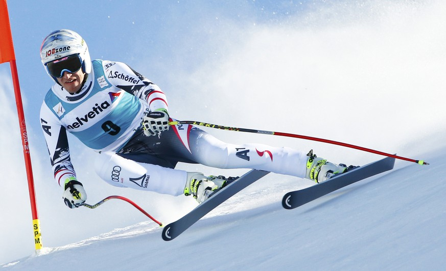 Matthias Mayer of Austria skis during the men's downhill event during the FIS Alpine Skiing World Cup finals in the Swiss ski resort of Lenzerheide March 12, 2014.         REUTERS/Ruben Sprich (SWITZERLAND  - Tags: SPORT SKIING)