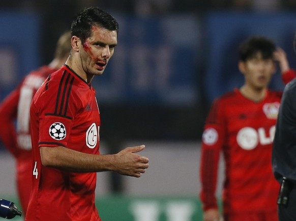 Leverkusen's Emir Spahic leaves the pitch bleeding during the UEFA Champions League group C soccer match between Zenit St. Petersburg and Bayer 04 Leverkusen in St.Petersburg, Russia, Tuesday, Nov. 4, 2014. (AP Photo/Dmitry Lovetsky)