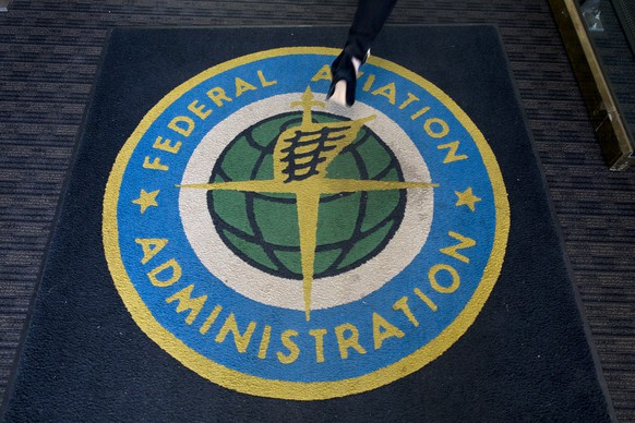 epa07434757 A woman walks over a carpet into the headquarters of the US Federal Aviation Administration (FAA) in Washington, DC, USA, 13 March 2019. The FAA announced the grounding of all Boeing 737 Max aircraft operated by US airlines or in US territories following the crash of Ethopian Airlines flight 302 on 10 March 2019 and the 29 October 2018 Lion Air crash. The order grounds over 70 aircraft, including both the Max 8 and Max 9.  EPA/MICHAEL REYNOLDS