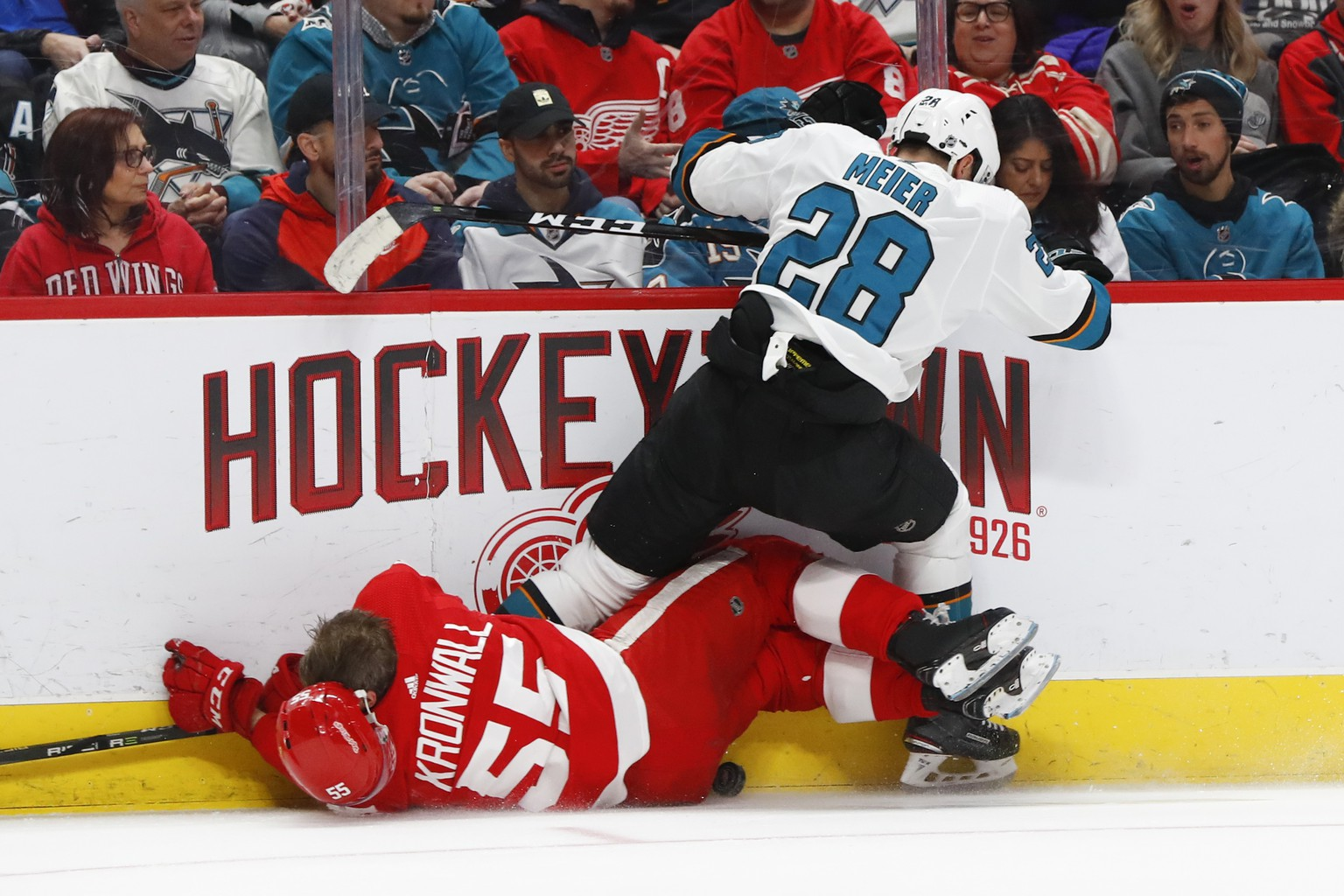 San Jose Sharks right wing Timo Meier (28) checks Detroit Red Wings defenseman Niklas Kronwall (55) in the first period of an NHL hockey game Sunday, Feb. 24, 2019, in Detroit. (AP Photo/Paul Sancya)