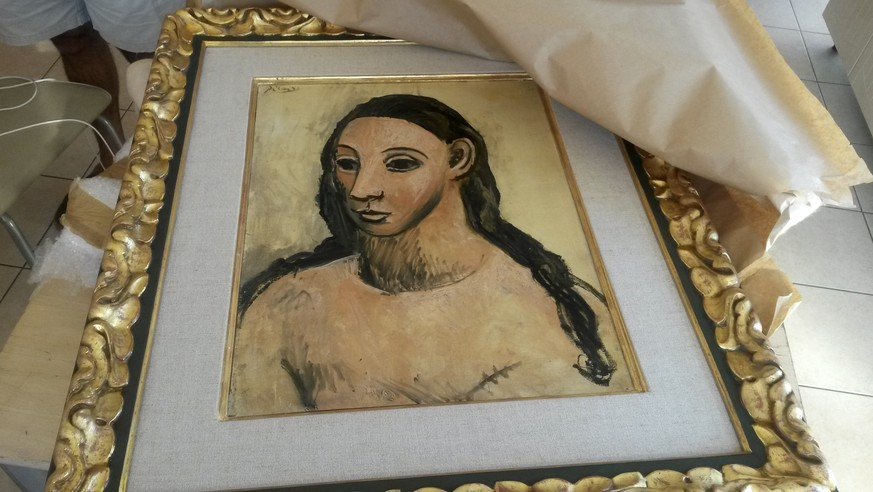 This photo taken on Friday, July 31, 2015 and made available on Tuesday, Aug. 11, 2015 by French Customs shows a 24 million-euro ($27.4 million) masterpiece by Pablo Picasso, seized from a boat cargo on July 31 from a boat cargo in Corsica, France. Corsican authorities said they were tipped off about an attempted smuggling of the prized 1906 painting,