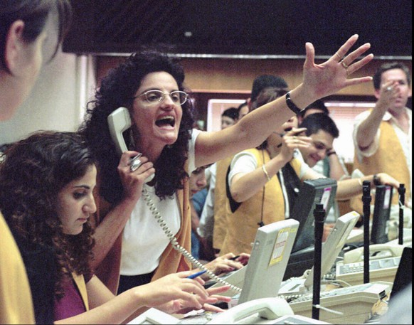 A broker at the Tel Aviv stock exchange yells Wednesday July 16, 1996 during a hectic trading session. Prime Minister Netanyahu's government is taking steps to restore public confidence Wednesday as the Israel stock market continued to fall with shares declining 15% in ten days.(AP PHOTO/Nati Harnik)