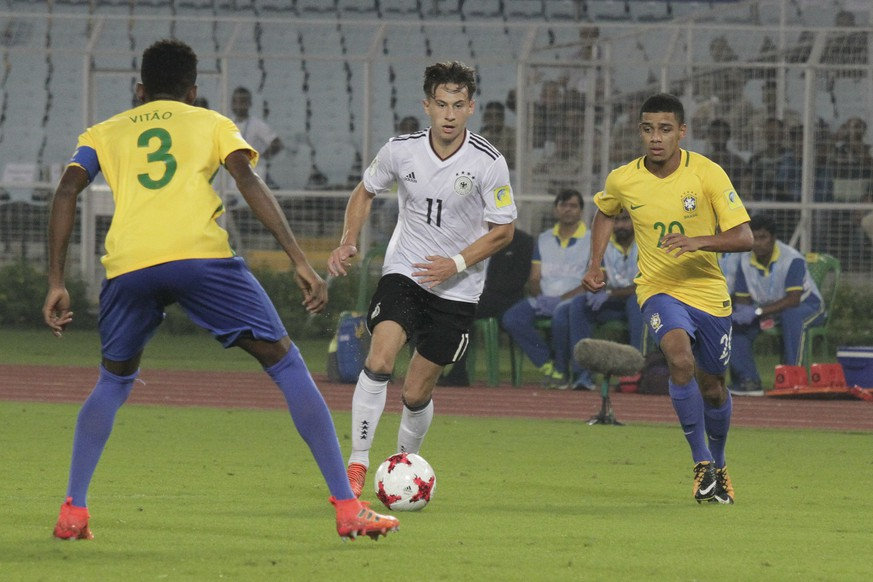 Brazil's Vitao Eduardo  duels for the ball against Germany's Nicolas Kuehn during their FIFA U-17 World Cup quarter final match in Kolkata, India, Sunday, Oct. 22, 2017. (AP Photo/Bikas Das)