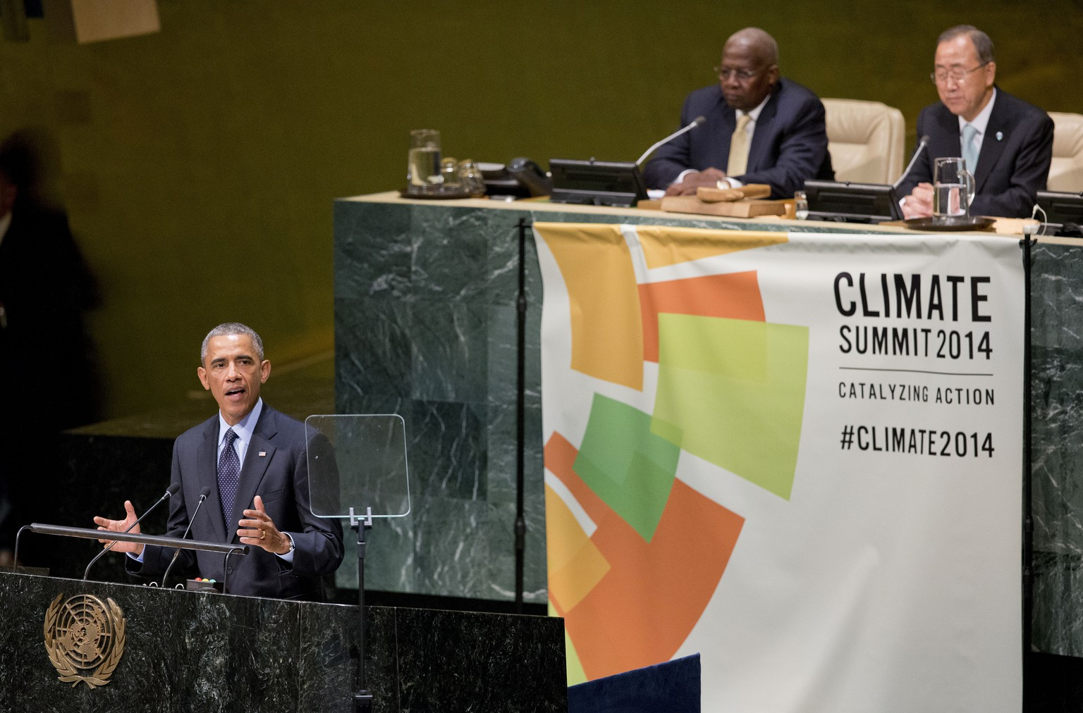 US President Barack Obama speaks at the Climate Summit 2014 at the UN General Assembly Hall, Tuesday, Sept. 23, 2014. Obama is in New York for three days of talks with foreign leaders at the annual United Nations General Assembly. On the far right look on is United Nations Secretary-General Ban Ki-moon. (AP Photo/Pablo Martinez Monsivais)