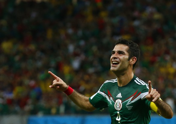 Mexico's Rafael Marquez celebrates scoring his team's first goal against Croatia during their 2014 World Cup Group A soccer match at the Pernambuco Arena in Recife June 23, 2014.  REUTERS/Paul Hanna (BRAZIL  - Tags: SOCCER SPORT WORLD CUP)