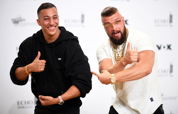 epa06664881 German musicians Kollegah (R) and Farid Bang (L) pose on the red carpet as they attend the 27th Echo 2018 music awards in Berlin, Germany, 12 April 2018. The awards are presented for outstanding achievement in the music industry.  EPA/CLEMENS BILAN