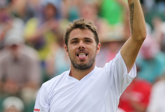 epa04293786 Stan Wawrinka of Switzerland celebrates after beating Feliciano Lopez of Spain during their fourth round match of the Wimbledon Championships at the All England Lawn Tennis Club, in London, Britain, 01 July 2014.  EPA/TATYANA ZENKOVICH