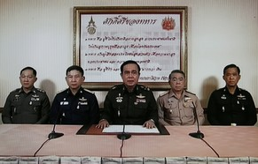 epa04218576 A TV grab shows Army Chief General Prayuth Chan-ocha (C) speaking next to Navy Chief Adm Narong Pipattanasai (2-R), Air Chief Marshall Prachin Chantong (2-L), Thai Police Chief Adul Saengsingkaew (L) and identified high rank military officer (R) during a military coup televised nationwide at the Army Club in Bangkok, Thailand, 22 May 2014. Thai Army chief Prayuth Chan-ocha announced a coup after his efforts to reconcile rival political factions failed.  EPA/RUNGROJ YONGRIT