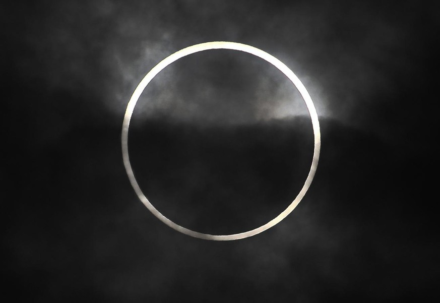 An annular solar eclipse in seen from Machida, on the outskirts of Tokyo, Monday, May 21, 2012. Millions across Asia are watching as a rare