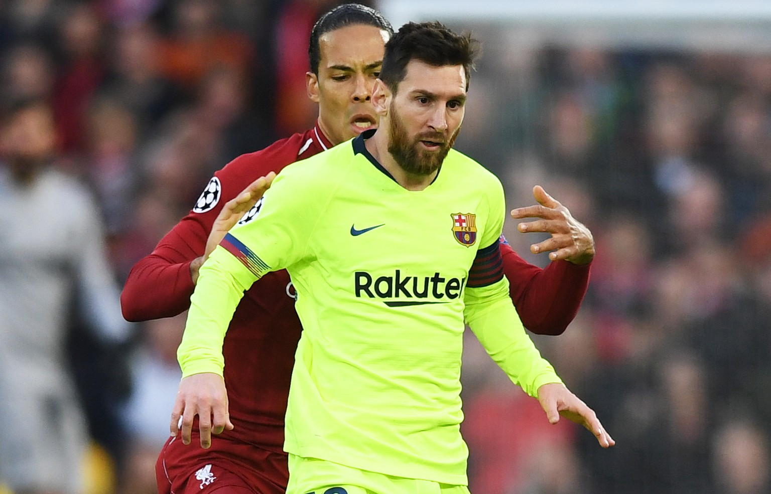 epa07554479 Virgil Van Dijk of Liverpool and Lionel Messi (front) of Barcelona in action during the UEFA Champions League semi final second leg soccer match between Liverpool FC and FC Barcelona at Anfield, Liverpool, Britain, 07 May 2019.  EPA/NEIL HALL