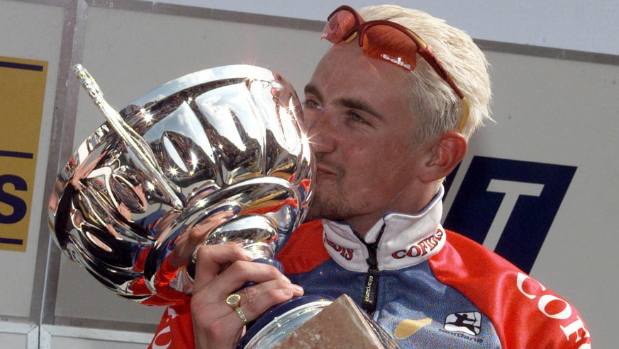 Belgian Frank Vandenbroucke kisses his trophy during the podium ceremony after winning the Liege-Bastogne-Liege cycling classic race in Liege Sunday afternoon, April 18, 1999. (AP PHOTO/ Gerard Guissard)