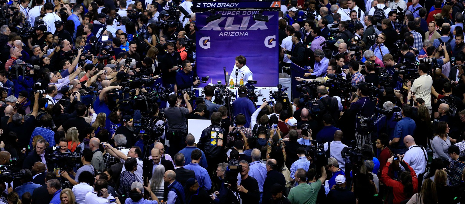 PHOENIX, AZ - JANUARY 27: Tom Brady #12 of the New England Patriots addresses the media at Super Bowl XLIX Media Day Fueled by Gatorade inside U.S. Airways Center on January 27, 2015 in Phoenix, Arizona.   Rob Carr/Getty Images/AFP == FOR NEWSPAPERS, INTERNET, TELCOS & TELEVISION USE ONLY ==