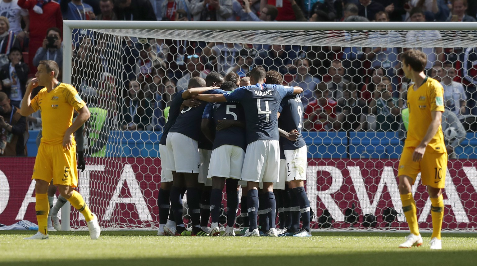 Members of the French team mob France's Antoine Griezmann after he scored the opening goal from the penalty spot during the group C match between France and Australia at the 2018 soccer World Cup in the Kazan Arena in Kazan, Russia, Saturday, June 16, 2018. (AP Photo/Pavel Golovkin)