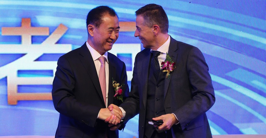 epa04612575 China's Wanda Group Chairman Wang Jianlin (L) shakes hands with Philippe Blatter, Infront's President and CEO during an agreement ceremony in Beijing, China, 10 February 2015. China's Wanda Group officially announced it has reached an agreement to acquire Swiss Infront Sports and Media from the European private equity firm Bridgepoint with a transaction valued at approximately 1.05 billion euro.  EPA/WU HONG