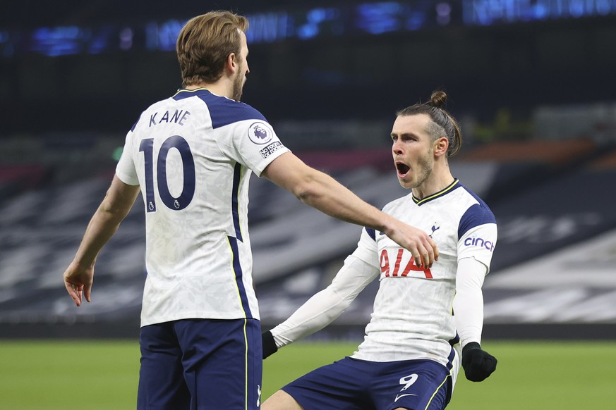 Tottenham's Gareth Bale, right, celebrates after scoring his side's second goal with Tottenham's Harry Kane during the English Premier League soccer match between Tottenham Hotspur and Crystal Palace at the Tottenham Hotspur Stadium in London, Sunday, March 7, 2021. (Julian Finney/Pool via AP)