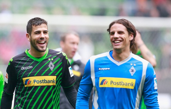 BREMEN, GERMANY - MAY 16: Alvaro Dominguez and Yann Sommer celebrate the victory after the Bundesliga match between SV Werder Bremen and Borussia Moenchengladbach at Weserstadion on May 16, 2015 in Bremen, Germany.  (Photo by Martin Stoever/Bongarts/Getty Images)