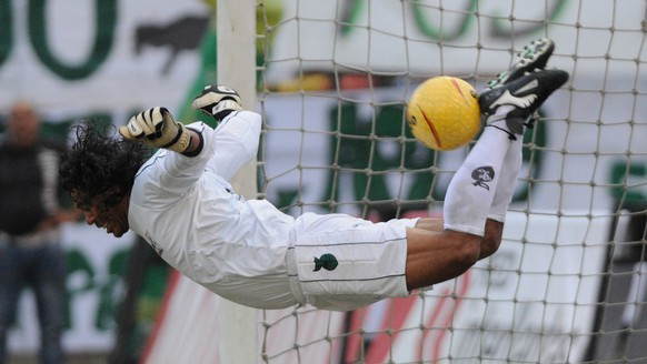 Goalkeeper Rene Higuita kicks the ball during his farewell match between a team of Colombia all-stars and top players from the 1990s of the Colombian club Atletico Nacional in Medellin, Colombia, Sunday, Jan. 24, 2010.  Higuita, 43, was famous for his frizzy hair and daring moves in goal. (AP Photo/Luis Benavides)
