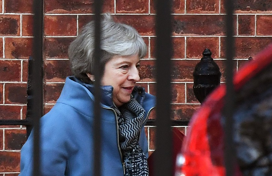 epa07269292 British Prime Minister Theresa May departs Downing Street for Parliament in London, Britain, 08 January 2019. Members of British Parliament will vote on the Brexit deal on 14 January 2019.  EPA/ANDY RAIN