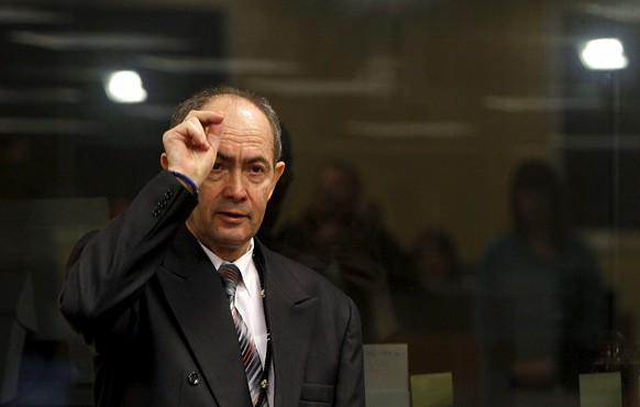 Former Bosnian Serb general Zdravko Tolimir crosses himself after arriving in the courtroom for the start of his trial at the Yugoslav war crimes tribunal in The Hague, in this file picture taken February 26, 2010. Tolimir, serving a life sentence for genocide during the bloody break-up of Yugoslavia in the early 1990s, died in The Hague on the night of February 8, 2016, a court spokesman said. Tolimir, 67, who was head of military intelligence in the Bosnian Serb army, was found guilty of genocide for crimes including the slaughter of 8,000 Muslim men and boys at Srebrenica, Europe's worst massacre since World War Two.    REUTERS/Bas Czerwinski/Pool/Files