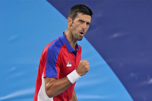 Novak Djokovic, of Serbia, reacts while playing Kei Nishikori, of Japan, during the quarterfinals of the tennis competition at the 2020 Summer Olympics, Thursday, July 29, 2021, in Tokyo, Japan. (AP Photo/Seth Wenig) Novak Djokovic