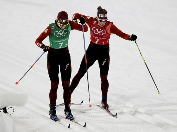 Der Graaff Laurien Van, of Switzerland, right. hands off to Nadine Faehndrich during the women's 4 x 5km relay cross-country skiing competition at the 2018 Winter Olympics in Pyeongchang, South Korea, Saturday, Feb. 17, 2018. (AP Photo/Kirsty Wigglesworth)