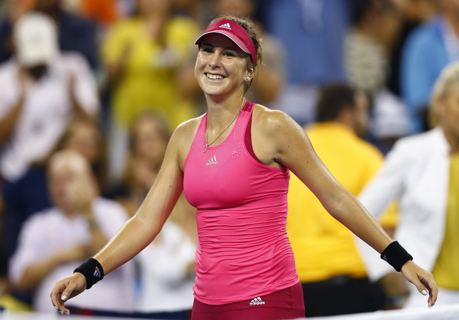 Belinda Bencic of Switzerland reacts after defeating Jelena Jankovic of Serbia during their women's singles match at the 2014 U.S. Open tennis tournament in New York August 31, 2014. REUTERS/Adam Hunger (UNITED STATES  - Tags: SPORT TENNIS)