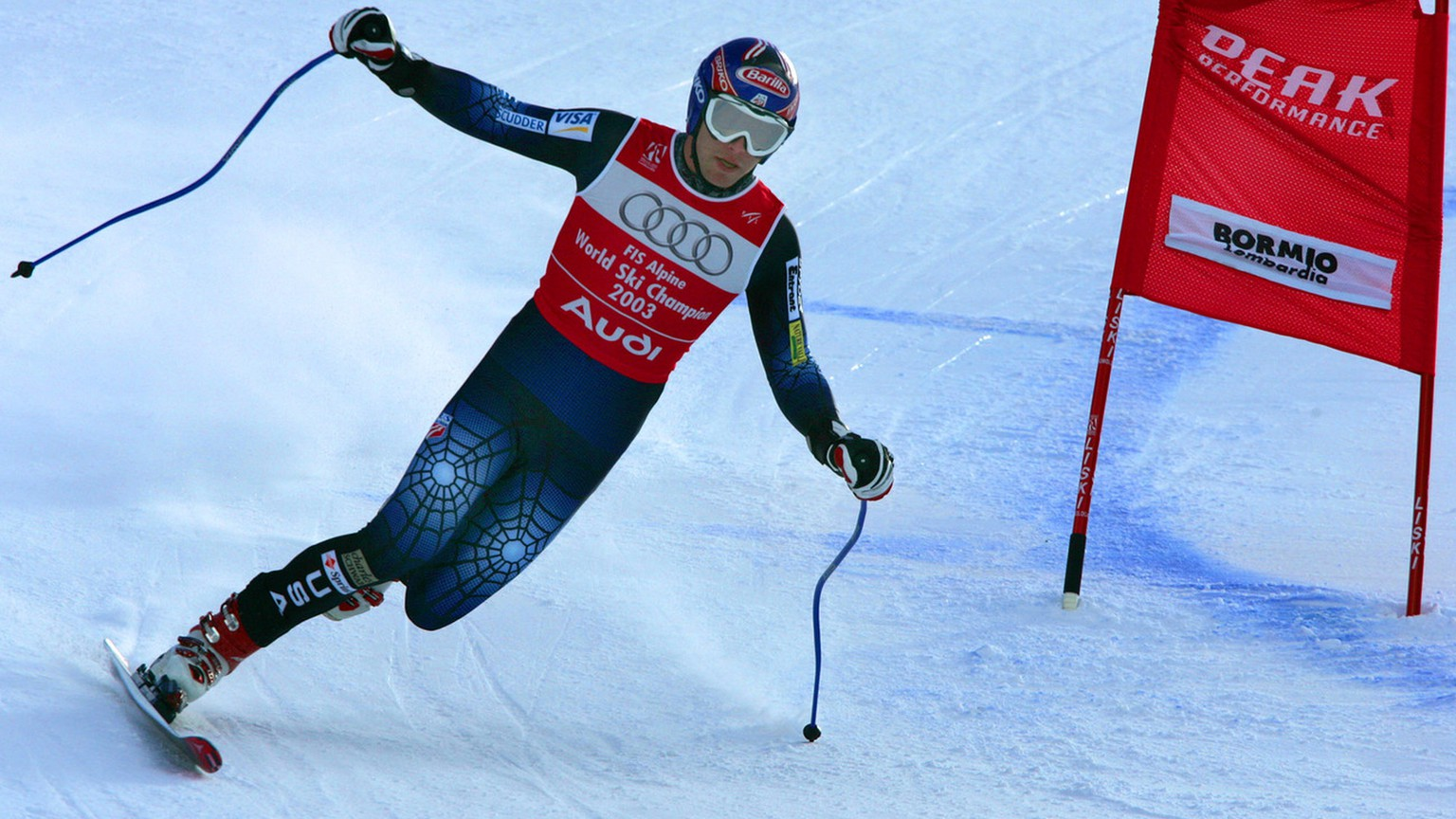Bode Miller of the United States makes a turn on one ski during the Downhill portion of the Men's Combined at the World Alpine Ski Championships in Bormio, Italy,  Thursday Feb. 3, 2005. Miller lost a ski near the top of the course and skied most of the way down on one ski before falling down near the bottom. (KEYSTONE/AP Photo/Diether Endlicher)
