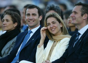 (FILES) (FromL) Princess Elena, Crown Prince Felipe, Infanta Cristina and her husband Inaki Urdangarin attend the mass celebrated by Pope John Paul II in Madrid's central Colon square, named after Christopher Colombus, 4 May 2003. Absent from her brother's oath swearing ceremony on Thursday, Cristina sister of soon to be proclaimed Spainish King, Felipe, is still waiting for judge Jose Castro to decided whether to send her back on trial over links to the business affairs of her husband Inaki Urdangarin, who is under investigation for alleged embezzlement of public funds.      AFP PHOTO/ VINCENZO PINTO