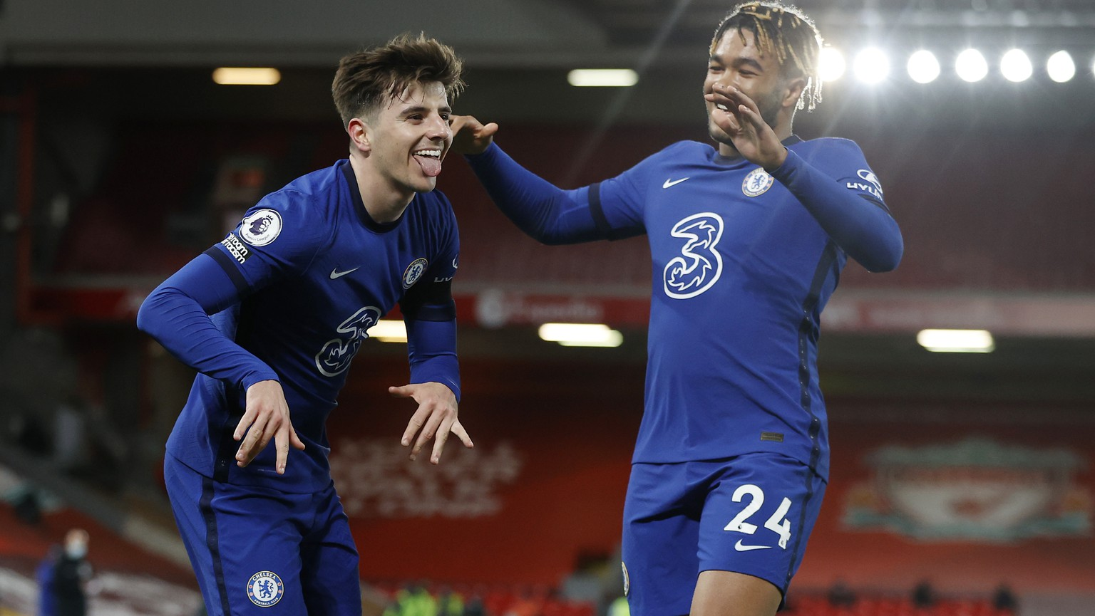 Chelsea's Mason Mount, left, celebrates with his teammate Reece James after scoring his side's opening goal during the English Premier League soccer match between Liverpool and Chelsea at Anfield stadium in Liverpool, England, Thursday, March 4, 2021. (Phil Noble, Pool via AP)
