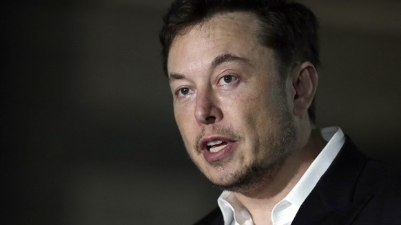 FILE - In this June 14, 2018, file photo, Tesla CEO and founder of the Boring Company Elon Musk speaks at a news conference in Chicago. Musk announced Tuesday, Aug. 7, that he is considering taking the electric car maker private, causing the company's stock to spike. (AP Photo/Kiichiro Sato, File)