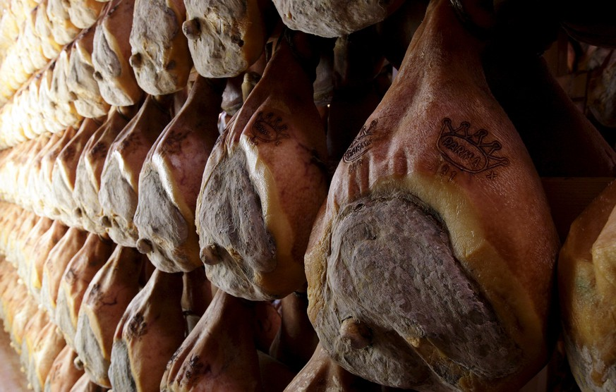 Lines of Parma ham are hung to dry in a special room in Langhirano, near Parma, in this October 13, 2009 file photo. The home of Parma ham, trumpeting the benefits of a traditional Mediterranean diet, is urging consumers not to get into a prosciutto panic after a warning that processed meat can cause cancer. Italian food and farming groups responded indignantly to the World Health Organization (WHO) report that put cured meats, such as ham, sausage and salami, together with asbestos and tobacco on a list of carcinogens. REUTERS/Stefano Rellandini/Files