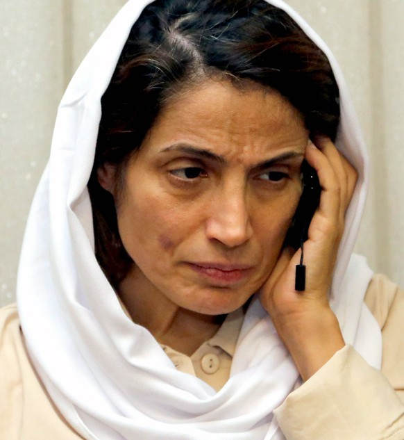 epa07431387 (FILE) - Human rights activist Nasrin Sotoudeh talks on the phone at her house in Tehran, Iran, 18 September 2013 (reissued 12 March 2019). According to media reports, prominent Iranian human rights lawyer Nasrin Sotoudeh, who has been since June 2018 in the Evin Prison in Tehran, was sentenced on 11 March 2019 by Iranian authorities to 148 lashes and 33 years in jail over charges for several national security-related offences. Human rights NGO Amnesty International criticized the sentencing calling it 'shocking' and 'outrageous injustice,' and demanded her immediate and unconditional release.  EPA/ABEDIN TAHERKENAREH *** Local Caption *** 51003987