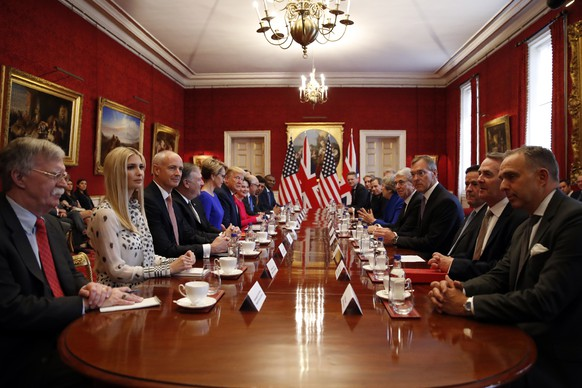 President Donald Trump, left center, and British Prime Minister Theresa May, right center, speak during a business roundtable event at St. James's Palace, Tuesday, June 4, 2019, in London. (AP Photo/Alex Brandon)