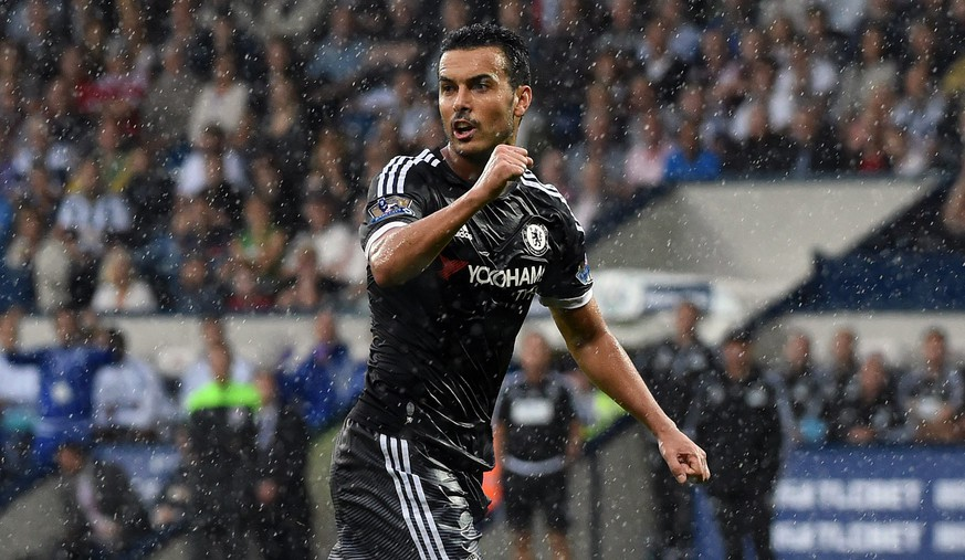 epa04894483 Chelsea's Pedro celebrates after Chelsea scored during the English Premier League soccer match between West Bromwich Albion and Chelsea at The Hawthorns Stadium in West Bromwich, Britain, 23 August 2015.  EPA/WILL OLIVER EDITORIAL USE ONLY. No use with unauthorized audio, video, data, fixture lists, club/league logos or 'live' services. Online in-match use limited to 75 images, no video emulation. No use in betting, games or single club/league/player publications.