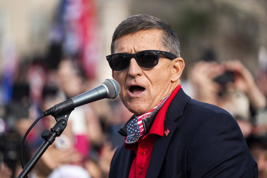 epa08879709 Former National Security Advisor and convicted felon Michael Flynn speaks to supporters of US President Donald J. Trump who gathered outside the Supreme Court to echo Trump's baseless claims of voter fraud in the US presidential election, in Washington, DC, USA, 12 December 2020. On 11 December, the high court rejected yet another legal challenge from the Trump campaign to overturn election results that went in favor of President-elect Joe Biden.  EPA/JIM LO SCALZO