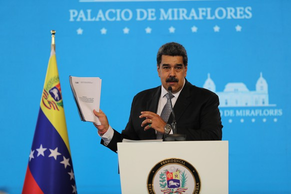 epa09019298 The president of Venezuela, Nicolas Maduro, speaks during a press conference at the Miraflores Palace, in Caracas, Venezuela, 17 February 2021. Maduro said that the immunization of health personnel against covid-19 will begin on 18 February, following the arrival of the first 100,000 doses of the Russian Sputnik V vaccine on 13 February.  EPA/Miguel Gutierrez