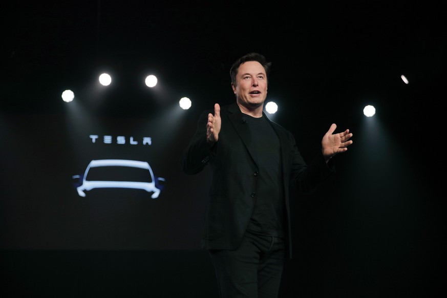 FILE- In this March 14, 2019, file photo Tesla CEO Elon Musk speaks before unveiling the Model Y at Tesla's design studio in Hawthorne, Calif. Musk was the top paid CEO in California for 2018, as calculated by The Associated Press and Equilar, an executive data firm. The survey includes only CEOs who have been in place for at least two years, but it does not limit the survey to companies in the S&P 500, as the AP's general compensation study does. That's why it includes Musk. Musk earned $2.28 Billion in 2018. (AP Photo/Jae C. Hong, File)