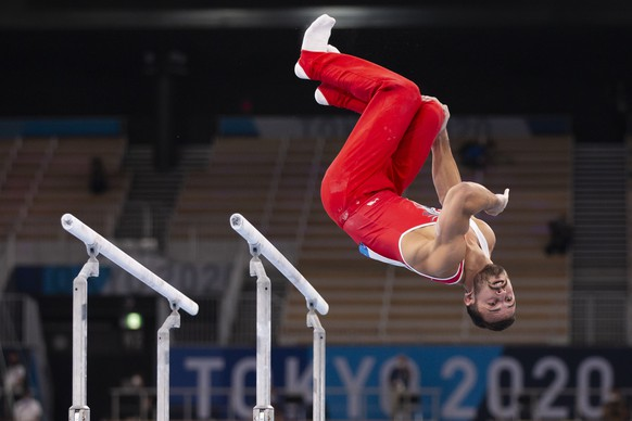 Pablo Braegger of Switzerland performs on the parallel bars during the men's artistic gymnastics qualification at the 2020 Tokyo Summer Olympics in Tokyo, Japan, on Saturday, July 24, 2021. (KEYSTONE/Peter Klaunzer)