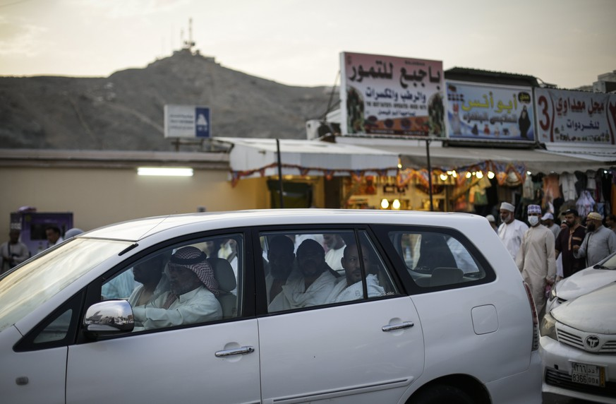 epa06170883 Muslim worshippers ride inside a car toward the Grand Mosque in Mecca, Saudi Arabia, 29 August 2017.   Around 2.6 million muslim are expected to attend this year's Hajj pilgrimage, which is highlighted by the Day of Arafah, one day prior to Eid al-Adha. Eid al-Adha is the holiest of the two Muslims holidays celebrated each year, it marks the yearly Muslim pilgrimage (Hajj) to visit Mecca, the holiest place in Islam. Muslims slaughter a sacrificial animal and split the meat into three parts, one for the family, one for friends and relatives, and one for the poor and needy.  EPA/MAST IRHAM