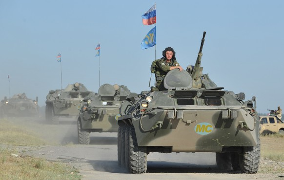 Russian soldiers of Rapid Deployment Forces of the Central Asian nations take part on August 1, 2014 in joint military exercises