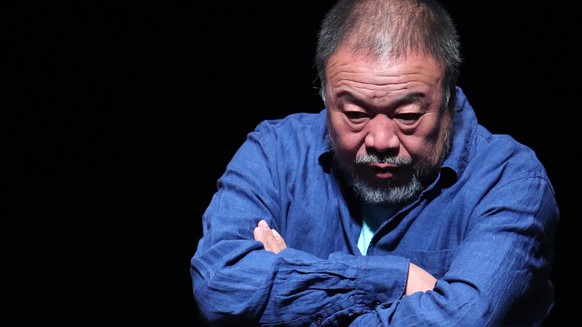 epa06743120 Chinese artist Ai Weiwei reacts at his exhibit 'Inoculation', in Santiago de Chile, Chile, 16 May 2018.  This is the first exhibition by the artist in Chile, and will be on view from 18 May to 09 September 2018.  EPA/MARIO RUIZ