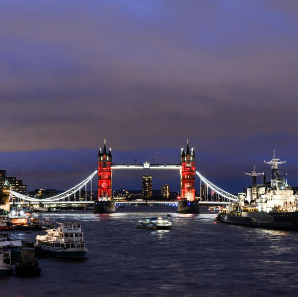 LONDON, ENGLAND - NOVEMBER 14:  As the sun sets, Tower Bridge is lit up in a succession of blue, white and red representing the French flag on November 14, 2015 in London, England.  The bridge is being lit in the wake of the Paris attacks, where many cities across the world are lighting their landmarks with the colors of France..  (Photo by Chris Ratcliffe/Getty Images)